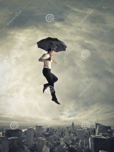 man-jumping-umbrella-under-him-there-s-city-31130656